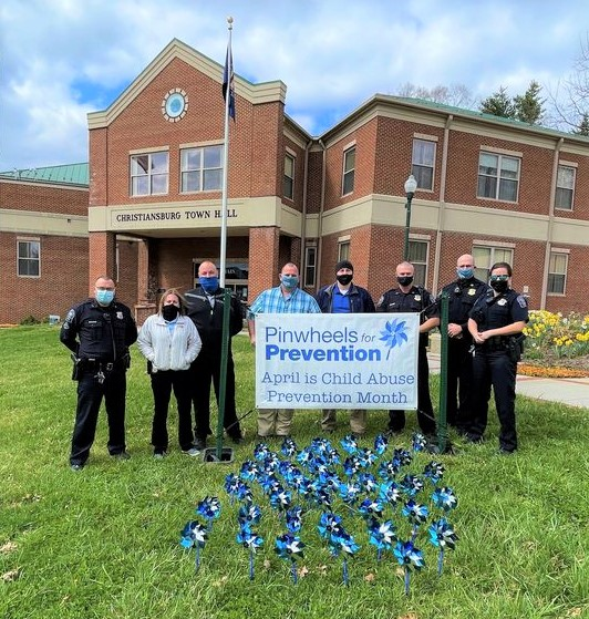 Town police plant pinwheels for Child Abuse Prevention Month